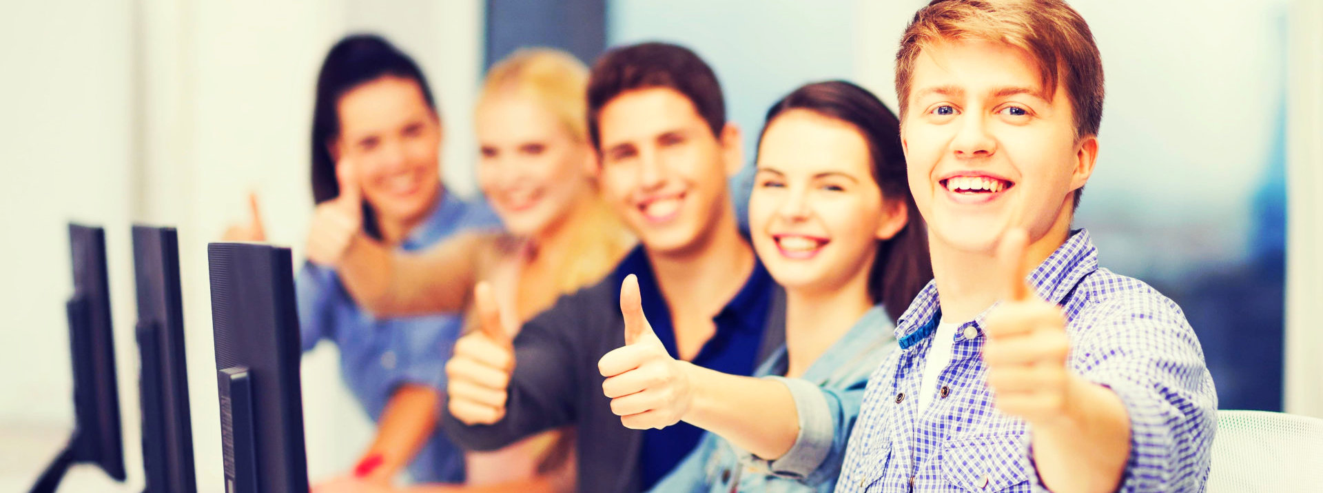 group of young people giving thumbs up