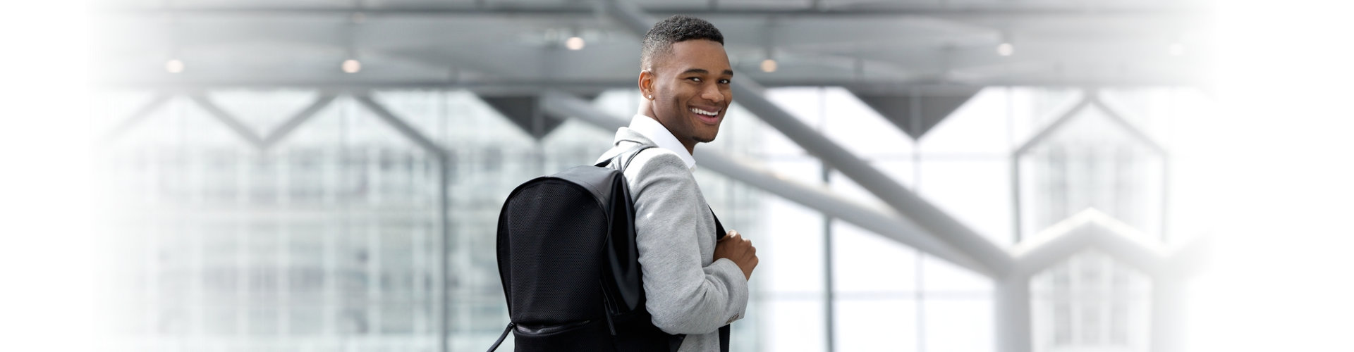 young man with his backpack