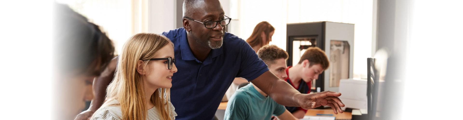 professor assisting his student